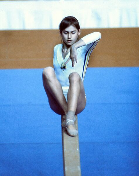 Gymnastics - 1976 Montreal Olympics - Women's Balance Beam Romania's Nadia Comaneci on the way to winning gold in the balance beam in the Montreal Forum, Quebec, Canada. The 14 year-old had earlier scored 10.0 in the team uneven bars
