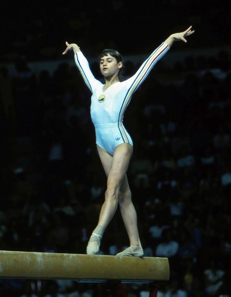 Gymnastics - 1976 Montreal Olympics - Women's Balance Beam Romania's Nadia Comaneci on the way to winning gold in the balance beam in the Montreal Forum, Quebec, Canada