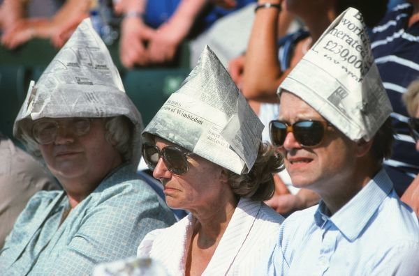 Tennis - The Wimbledon crowd cover up from the sun with their paper hats on centre court. Wimbledon tennis Championships 1992. Credit: Colorsport