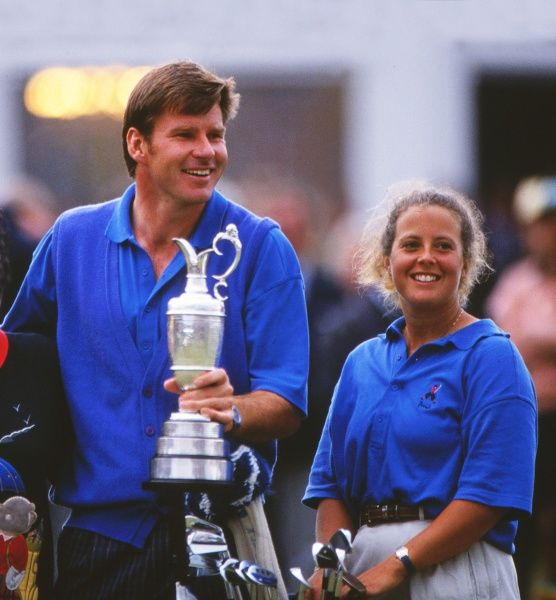 Golf - Trophy Presentation. Nick Faldo with Caddie Fanny Sunnesson celebrate winning the Open Championship