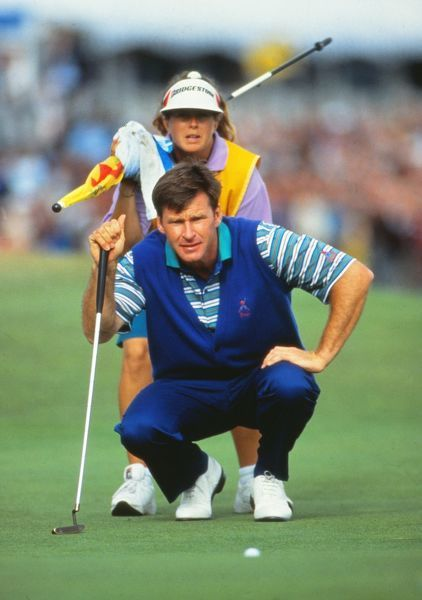 Golf Nick Faldo lines up a putt with his caddy Fanny Sunesson. He finished runner-up