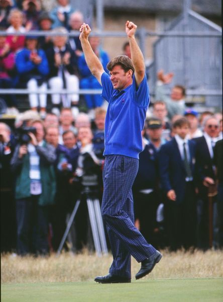 Nick Faldo raises his arms after winning the Open Championship.  Open Golf Championship, Muirfield, Scotland, 19/07/1992.  Credit: Colorsport / Stuart MacFarlane