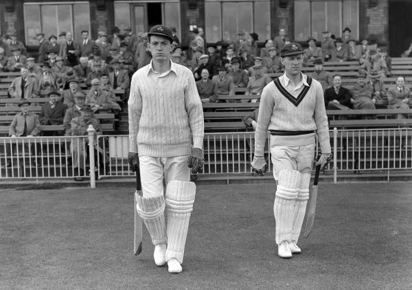 Cricket - 1956 County Championship - Lancashire vs. Sussex Geoffrey 'Noddy' Pullar, left, and Alan Wharton walk out to bat for Lancashire at Old Trafford. Pullar made 312 first-class appearances for Lancashire between 1954 and 1968, scoring 16853 runs