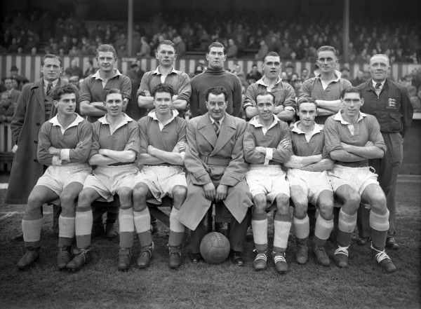 Football - 1951 / 1952 season - Northampton Town Team Group Back (left to right): J. French, M. Candlin (captain), Collins, Sonny Feehan (goalkeeper, also played for Manchester United ), J. Wilson, G. Hughes, T. Jennings (trainer). Front: F