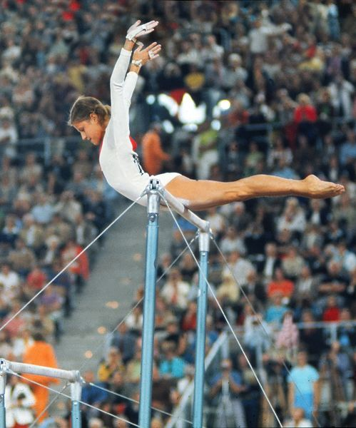 Gymnastics - 1972 Munich Olympics - Women's Uneven Bars The USSR's Olga Korbut on the way to winning the silver medal in the uneven bars in the Sports Hall, Olympic Park, Munich, West Germany