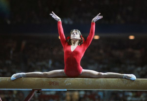 Gymnastics - 1976 Montreal Olympics - Women's Balance Beam USSR's Olga Korbut (USSR) on the way to winning the silver medal in the balance beam. She would finish fifth in the individual all-round but won a gold medal in the team all-round