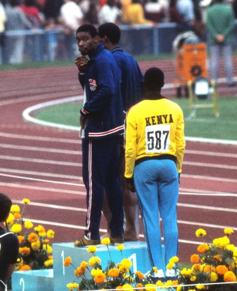 Athletics - 1972 Munich Olympics - Men's 400m Medal Presentation USA's gold medal winner Vince Matthews (facing camera) shows his disinterest in the ceremony, while silver medalist and compatriot Wayne Collett stands alongside him on the no