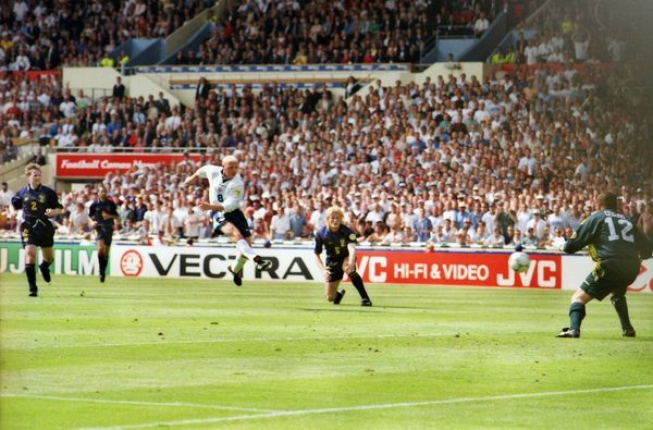 Football - Euro 96 - Group A: England 2 Scotland 0 (15/06/96) Paul Gascoigne scores a brilliant volley past Andy Goram (right) and Colin Hendry. at Wembley