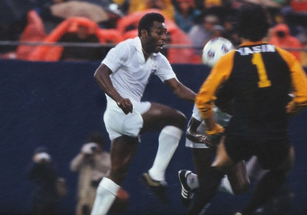 Football Pele (Santos) bears down on Cosmos keeper Yashin. Pele had changed shirts and played the second half of the game for his old club Santos. Pele's farewell game. Cosmos v Santos, Giants Stadium, New York, 01/10/1977