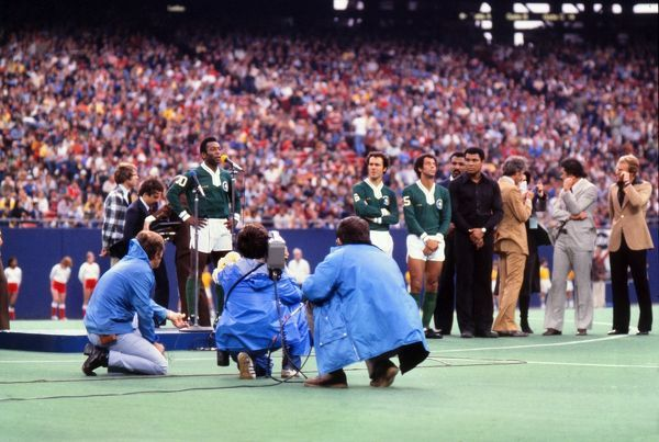 Football Pele (Cosmos) gives his farewell speech before his final match, in which he asked the crowd to chant 'love' five times with him.  To the right is Cosmos players Franz Beckenbauer and Alberto Carlos, as well as boxer Mohammad Ali