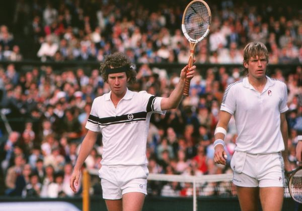 Tennis - 1981 Wimbledon Championships - Men's Doubles Final Peter Fleming and John McEnroe celebrate victory on Centre Court after defeating Bob Lutz and Stan Smith 6-4, 6-4, 6-4