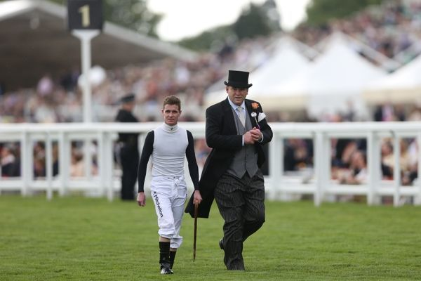 Horse Racing - Royal Ascot 2012 - Final Day Trainer Peter Moody (right) and Jockey Luke Nolan (left) walk the track before the Diamond Jubilee Stakes at Royal Ascot 2012