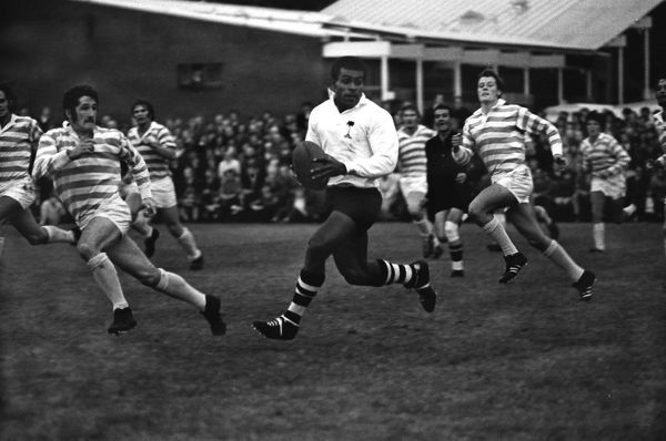 Rugby Union - 1970 Fiji Tour of England and Wales - Cambridge University 12 Fiji 8 Fiji's Pio Bosco Tikoisuva on the ball, with Cambridge's Gerald Davies, left, during the game at Grange Road, Cambridge