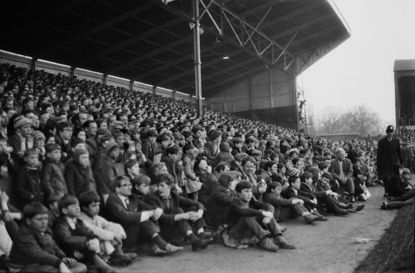 Football - Preston North End v Blackpool Preston fans cram under the stand to watch the promotion chasing Blackpool team 13/04/1970 Credit : Colorsport