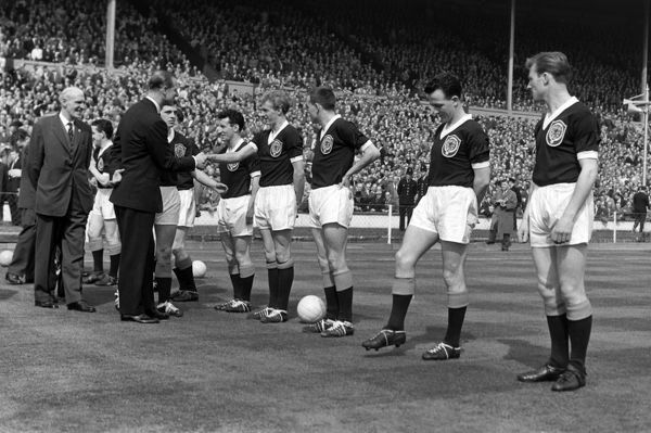 Football - HRH Prince Phillip the Duke of Edinburgh, shakes hands with Denis Law (Scot). England v Scotland @ Wembley. 15/04/1961 Home Internationals Credit : Colorsport