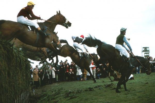 Horse Racing - 1976 Grand National - Aintree Red Rum (#1), ridden by Brian Fletcher (yellow cap), clears Becher's Brook fence. Red Rum finished second for the second year running