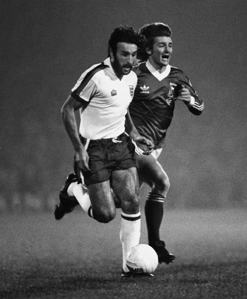 Ricardo 'Ricky' Villa wears the England shirt instead of is Argentina one. Russell Osman (Ipswich)  Ipswich Town v England X1 Bobby Robson Testimonial match.  13/11/1979  Credit Colorsport /Andrew Cowie
