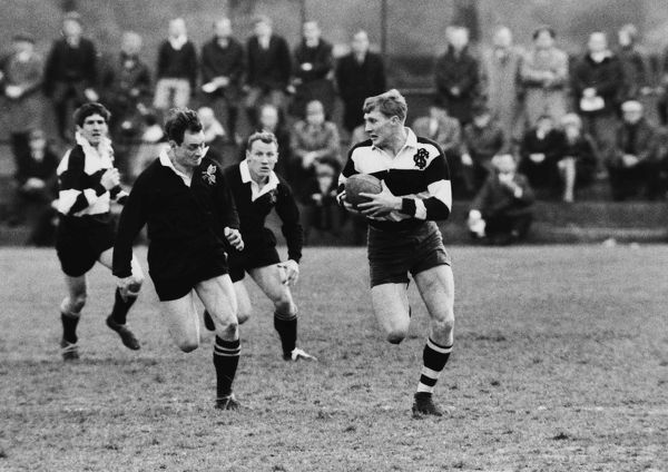 Rugby Union - 1966 / 1967 season - Wasps 8 Barbarians 36 Rodney Webb (Coventry) of the Barbarians runs with the ball at Sudbury. The game was played to mark Wasps' centenary