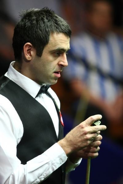 Snooker - The World Championship Ronnie O'Sullivan chalks his cue during his tie against Liang Wenbo at the Crucible Theatre, Sheffield