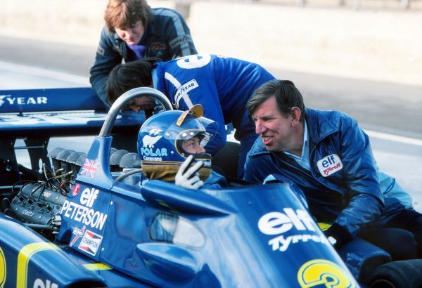 Motor Racing - Ken Tyrrell (right) founder of the Tyrrell team,talks with Ronnie Peterson Nov 1976 Credit : Colorsport