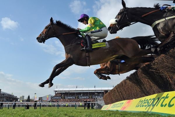Horse Racing - Cheltenham Festival - Day 4 - 3.20pm The Totesport Cheltenham Gold Cup Steeple Chase Ruby Walsh on Kauto Star clears the last fence on the second circuit of the Gold Cup at Cheltenham racecourse
