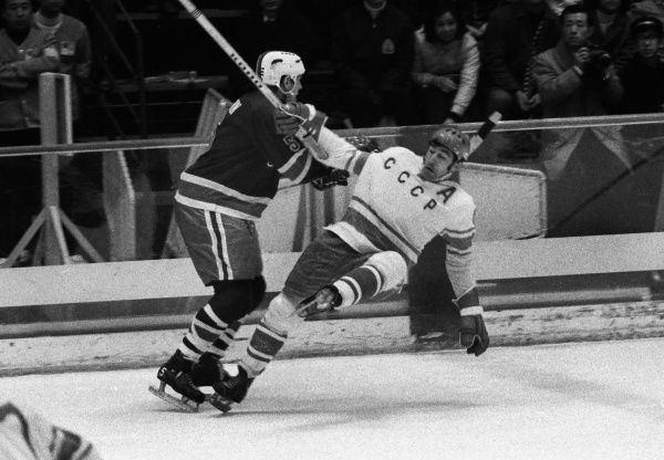 Ice Hockey - 1972 Sapporo Winter Olympics - Final Round: USSR 7 USA 2 The USA's Charles Brown (#5) clatters into a Russian at Sapporo, Japan. The Soviet Union went on to win the gold medal, and the USA the silver. 09/02/1972