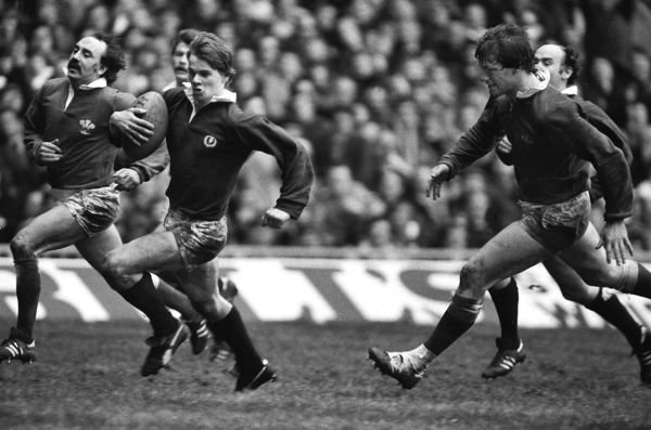 Rugby Union - 1982 Five Nations Championship - Wales 18 Scotland 34 Scotland's David Johnston goes over to score his try at Cardiff Arms Park, with Clive Rees, left and John Rhodri Lewis, right