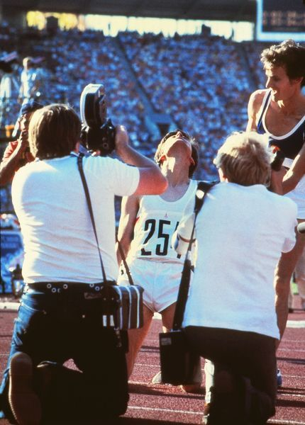 Athletics - 1980 Moscow Olympics - Men's 1500m Final Great Britain's Sebastian Coe (#254) drops to his knees after winning the gold medal in the Grand Arena of the Central Lenin Stadium, Moscow, USSR. East Germany's silver medal winner Jurgen Straub (#338)