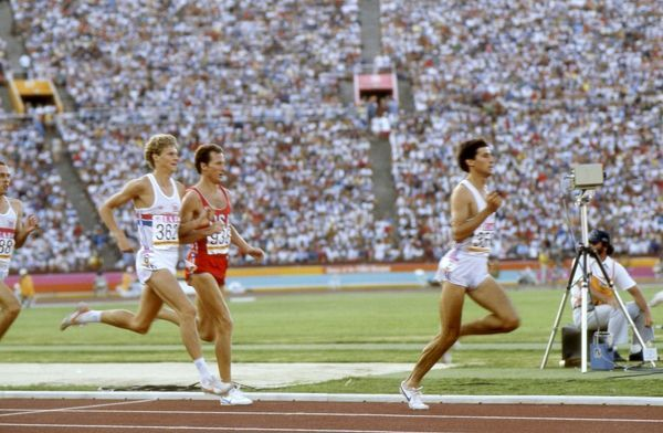 Athletics - 1984 Los Angeles Olympics - Men's 1500 metres Final Great Britain's Sebastian Coe leads from the USA's Steve Scott and compatriot Steve Cram, with Steve Ovett far left, in the Memorial Coliseum, California