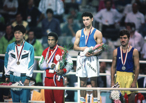 Boxing - 1988 Seoul Summer Olympics - Men's Featherweight (57kg) Medal Presentation    The medal winners on the podium at the Jamsil Students' Gymnasium, Seoul Sports Complex, Seoul.   (l-r): Lee Jae-hyuk (bronze - South Korea)