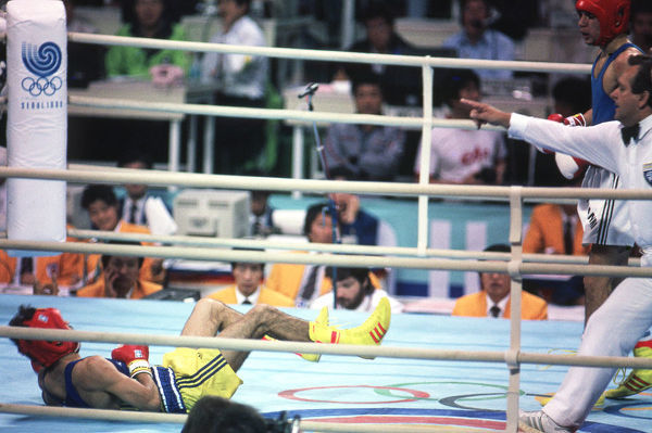 Boxing - 1988 Seoul Summer Olympics - Men's Featherweight (57kg) Final: Giovanni Parisi (Italy) vs. Daniel Dumitrescu (Romania)    Parisi knocks down Dumitrescu to win the gold medal, at the Jamsil Students' Gymnasium, Seoul Sports Complex, Seoul