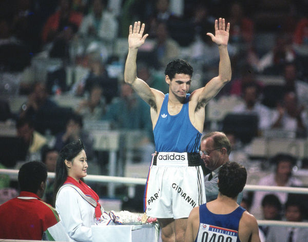 Boxing - 1988 Seoul Summer Olympics - Men's Featherweight (57kg) Medal Presentation    Giovanni Parisi (Italy) takes the applause before receiving his gold medal, at the Jamsil Students' Gymnasium, Seoul Sports Complex, Seoul