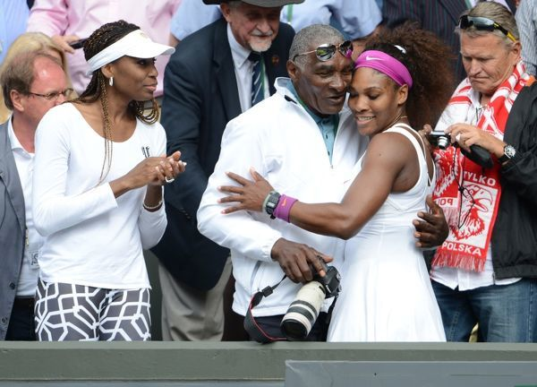 Wimbledon Week 2 : Tennis Championships 2012 Ladies singles final. Credit : Andrew Cowie / Colorsport. 07/07/2012  Serena Williams v Agnieszka Radwanska. Serena Williams - USA climbs up into the players box to greet her father and her sister Venus