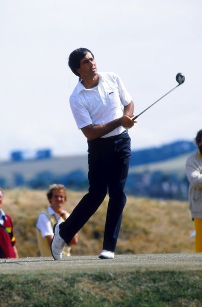 "Golf - The Open Championship 1984 - Final Round Severiano ""Seve"" Ballesteros keeps a close eye on his tee shot on his way to victory at St. Andrews"