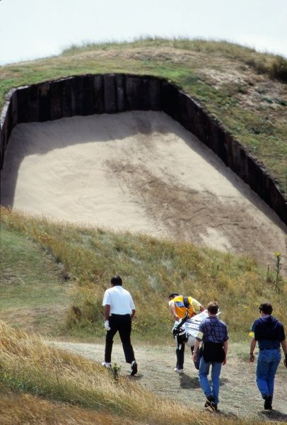 Golf Seve Ballesteros walks past the famous fourth-hole bunker at Royal St. George's, the deepest bunker in championship golf. 1993 Open Championship Royal St George's Golf Club, Sandwich