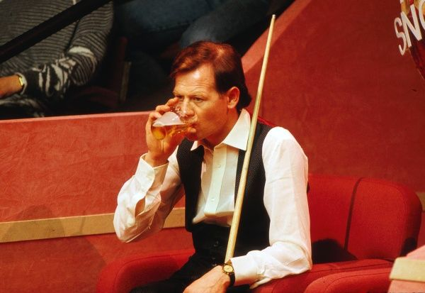 Snooker - World Championships 1988  Alex Higgins of Ireland drinks a pint of beer during his match at the Crucible Theatre