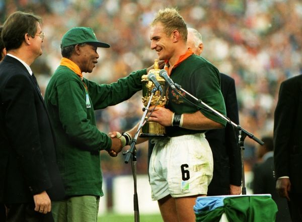 Rugby Union - 1995 World Cup Final - South Africa 15 New Zealand 12 Springbok captain Francois Pienaar receives the Webb Ellis Cup from South Africa President Nelson Mandela at Ellis Park, Johannesburg. 24/06/1995