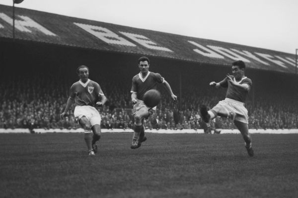 Stanley Matthews competes with John Bramwell and Bobby Collins for the ball in 1958