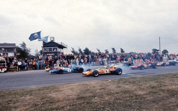 Motorsport - Formula One F1 World Championships - 1969 British Grand Prix Silverstone Start of the race, with Ford dominating the front row, Jochen Rindt - Lotus Ford (2), Jackie Stewart - Matra Ford (3) and Denny Hulme - McLaren Ford (5)