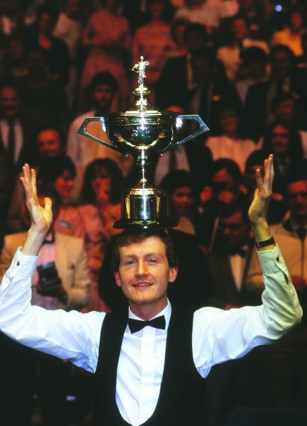 Snooker - 1987 Embassy World Snooker Championship Final - Steve Davis vs. Joe Johnson Steve Davis celebrates victory in the Crucible Theatre, Sheffield, by placing the trophy on his head. It was Davis' fourth world title