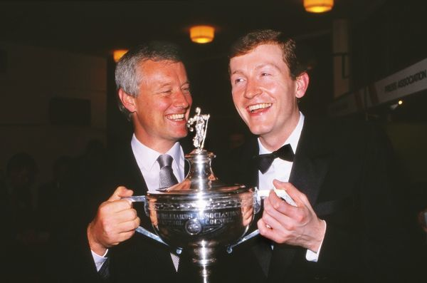 Snooker - Snooker World Championships - Final Steve Davis (right)and Promoter and Manager Barry Hearn celebrate with the trophy after winning the World title