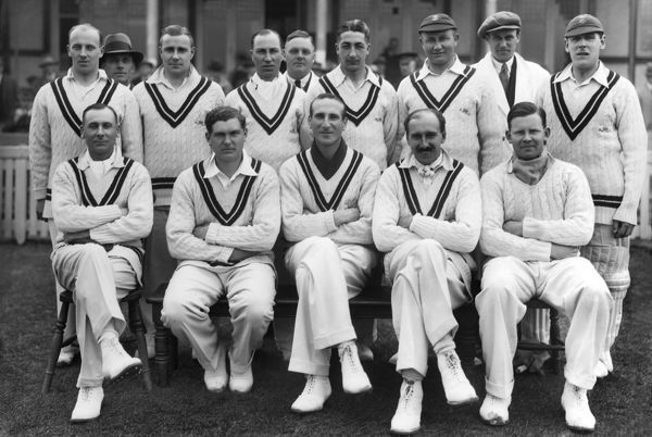 Cricket - 1932 season - Surrey County Cricket Club Team Group   Back (left to right): Gregory, Barling, Andrew Sandham, Umpire, Squires, Shepherd, Umpire (Austin), Brooks.  Front: Sir Jack Hobbs, Maurice J. Allom, Douglas Jardine, P. G. H. 'Percy' Fender