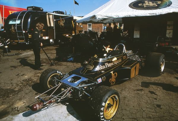 Motor Racing/Formula 1 Emerson Fittipaldi's car in the Team Lotus garage decked out in the iconic black and gold livery of the John Player Special brand