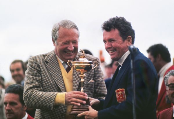 Golf - 1973 Ryder Cup - Great Britain and Ireland 13 USA 19 Prime Minister Ted Heath presents the Ryder Cup to the USA's captain Jack Burke after his side's victory at Muirfield, Scotland