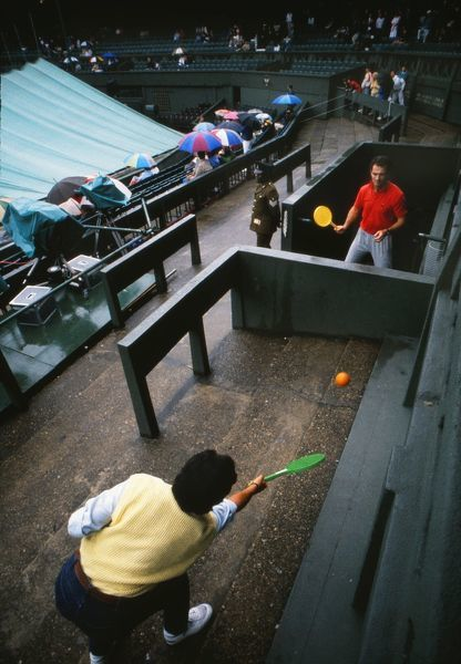TENNIS - RAIN STOP PLAY.  Fans play their own version of tennis on centre court after rain stops play in 1988 1988 Wimbledon tennis Championships CREDIT : COLORSPORT /ANDREW COWIE