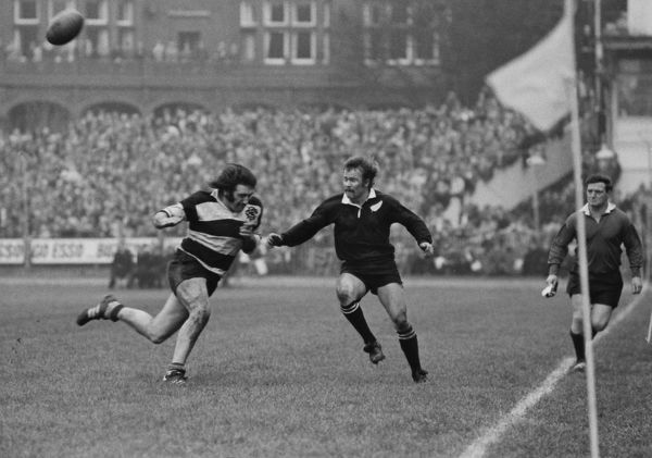 Rugby Union - 1972 / 1973 New Zealand Tour of Great Britain & France - Barbarians 23 New Zealand 11 Tom David of the Barbarians about to tackle Grant Batty off the ball at Cardiff Arms Park. The Barbarians defeated the All Blacks for the first time
