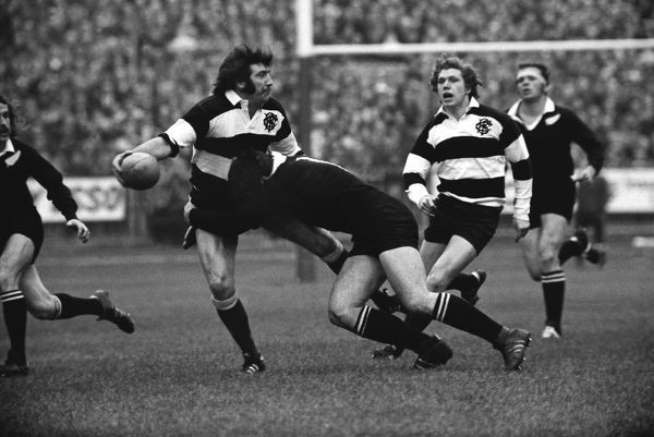 Rugby Union - 1972 / 1973 New Zealand Tour of Great Britain & France - Barbarians 23 New Zealand 11 Tom David of the Barbarians passes the ball back inside in the build-up to Gareth Edwards (not pictured) famous try at Cardiff Arms Park