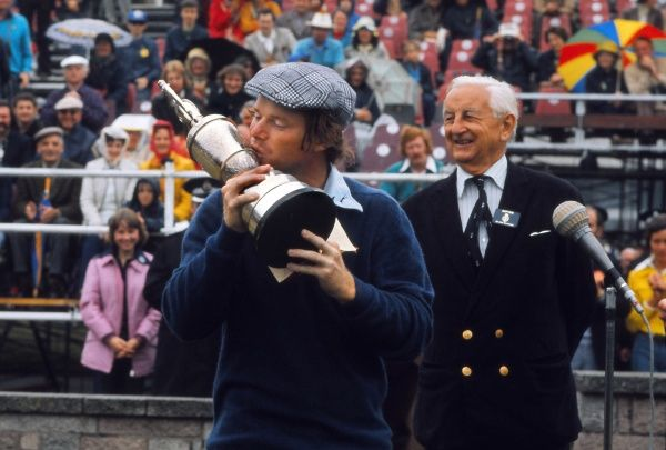 Golf - The Open Championship Tom Watson (USA) celebrates winning the Open with the trophy.  British Open Golf Championships 1975 @ Carnoustie.  12/07/1975 Credit : Colorsport