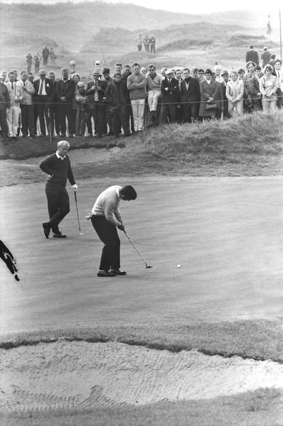Golf - 1969 Ryder Cup - Great Britain & Ireland 16 USA 16 (USA retains trophy) Great Britain's Tony Jacklin putts as Jack Nicklaus watches in their day 3 singles match at Royal Birkdale