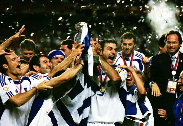 Football - European Championships Final 2004 - Greece vs. Portugal Traianos Dellas of Greece celebrates with the trophy after the final in Lisbon
